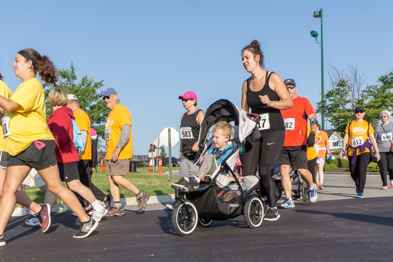 Participants, including families with strollers