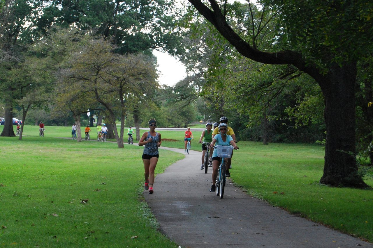 Bicyclists and joggers on trail