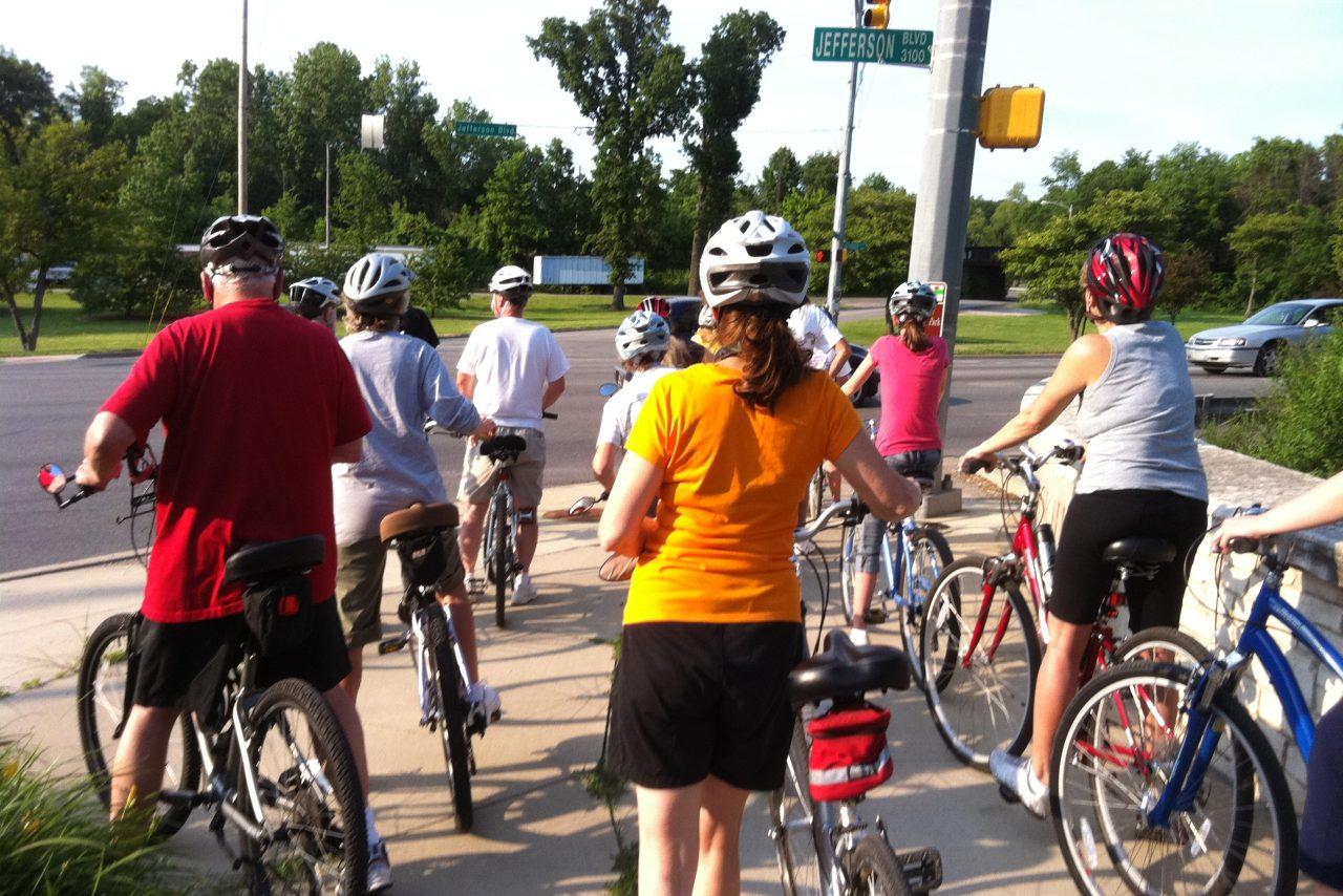 Group of cyclists at stop light