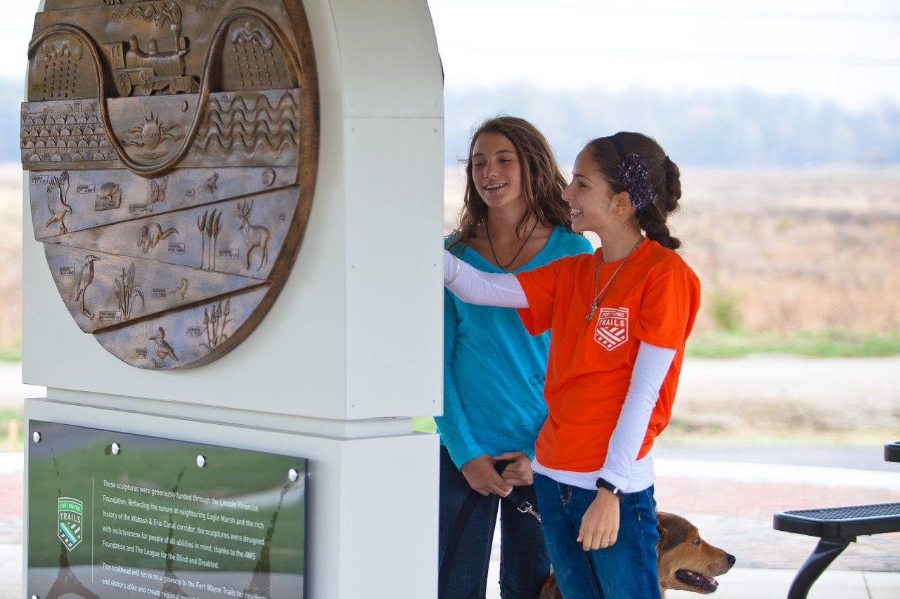 Girls viewing sculpture at Towpath Trailhead